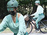 Jennifer Lopez flaunts her assets in skintight peacock patterned spandex while out biking solo