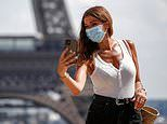 Parisians are seen in masks after French capital ordered face-coverings must be worn at landmarks