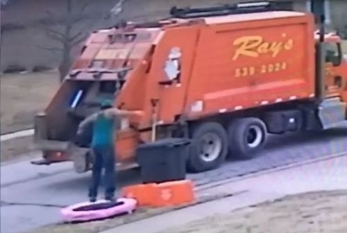 Binman jumps up and down on dumped trampoline