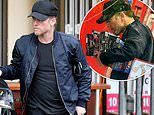 Sam Worthington rocks a ponytail under his cap as stops by a Sydney toy shop