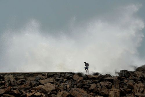 What is the difference between a cyclone and a hurricane as Cyclone Amphan approaches the Indian coast?