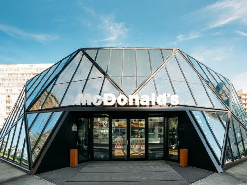 A modern, glass-walled McDonald's is one of the most beautiful fast-food restaurants in the world