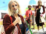 Pregnant Ashlee Simpson covers bump in velour duster on LA errand trip with her son Bronx