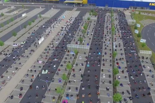 Incredible image shows Muslims using Ikea car park to pray safely