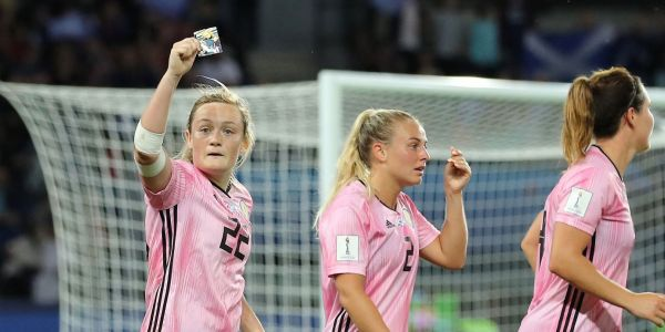 Scottish striker celebrates World Cup goal by kissing a picture of herself as a child her father gave to remind her of where she started