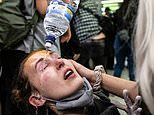 Incredible moment a Black Lives Matters protester pepper sprayed by police unleashes on cops