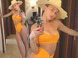 Lala Kent of Vanderpump Rules poses in a bright orange bikini