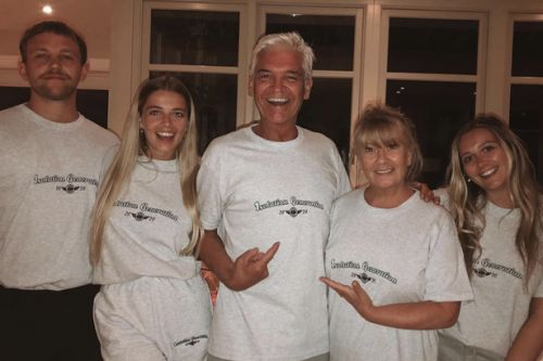 Phillip Schofield grins as he cosies up to family in matching isolation pyjamas