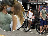 Gerard Butler gets kiss from galpal Morgan Brown as couple enjoy bike ride around LA's Venice Beach