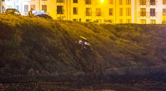 Pictured: Car plunges down embankment at Northern Ireland beach
