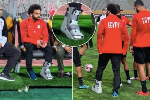 Liverpool left sweating on fitness of Mohamed Salah as Egyptian is seen wearing protective boot