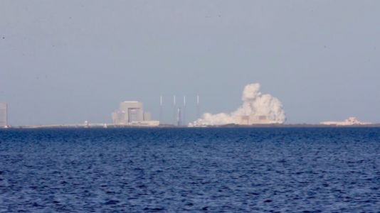 SpaceX test-fires reused rocket in preparation for space station cargo mission