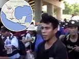 Caravan of 3,000 migrants push past Mexican police as they storm towards the US border