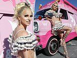 Courtney Act looks fierce in a crop top and mini skirt ahead of Mardi Gras