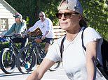 Robin Wright, 54, keeps svelte figure in shape on sunny bike ride with husband Clement Giraudet, 35