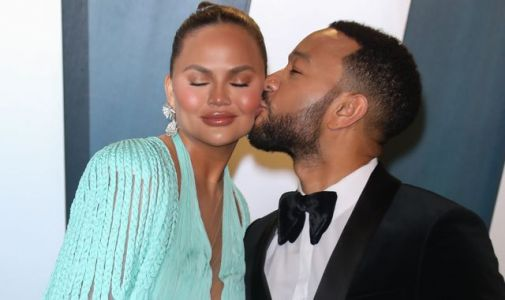 Chrissy Teigen and John Legend reveal their third baby is on its way. in a music video