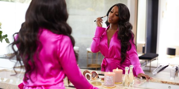 YouTube star Jackie Aina describes the 2-year process of creating her new 'affordable luxury' brand launching with candles inspired by her memories
