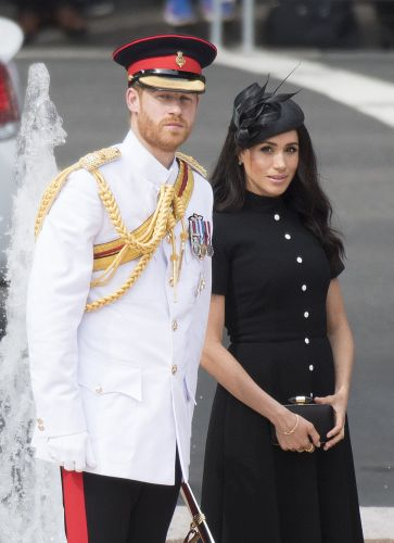 Prince Harry is an officer and a gentleman as he and Meghan lay wreath for war dead in Sydney