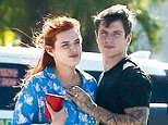 Bella Thorne enjoys a very public display of affection with fiancé Benjamin Mascolo
