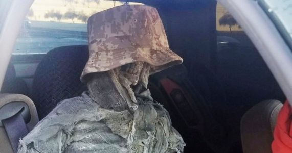 Driver caught using carpool lane with fake skeleton in a bucket hat tied to seat