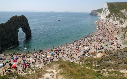 Travel updates: 'People are going to drown' - packed UK beaches struggle without RNLI