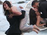 Ana De Armas gets swept into arms of smoldering male model during beach shoot for perfume ad