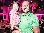 Tyson Fury dances with daughters Venezuela, 11, and Valencia, 3, during DJ night at Miami restaurant