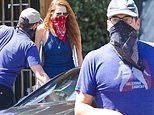 Jon Hamm is a chivalrous boyfriend to his injured partner Anna Osceola as he helps her into the car