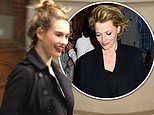 Lily James looks effortlessly stylish as she departs theatre