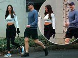 Nathan Buckley enjoys a morning stroll with his girlfriend Alex Pike ahead of his final AFL game