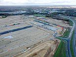 Brexit: Drone photos reveal 27-acre Kent field as workers turn it into park for 1,700 lorries