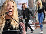 Amber Heard packs on the PDA with new girlfriend Bianca Butti at 4th Annual Women's Day March in LA