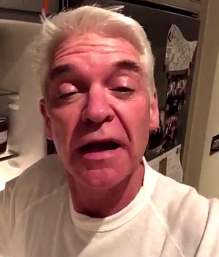 Bleary-eyed Phillip Schofield nurses a hangover after very boozy This Morning Christmas party with Holly Willoughby