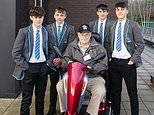 Four boys, 14, push a pensioner, 90, and his broken-down mobility scooter for a MILE to get him home