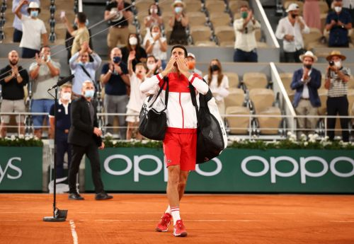 'Merci, Macron': French Open crowd delight after curfew is scrapped for Djokovic-Nadal epic