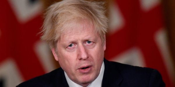 Theresa May blasts her successor Boris Johnson for abandoning the UK's 'global moral leadership'