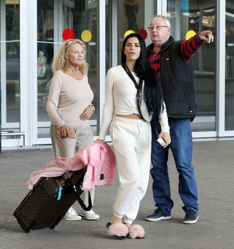 Katie Price puts on her pink fluffy slippers to jet off to Spain on another holiday with mum Amy
