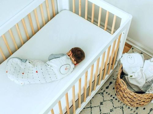 This weighted sleep sack mimics the feeling of your hand on your baby's stomach or back - my 1-year-old daughter sleeps 12-hour nights now