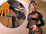 Megan Thee Stallion flashes derriere in catsuit with sheer cutouts at the 2021 US Grand Prix in TX