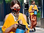 Olivia Palermo cuts a stylish figure in a silky brown skirt