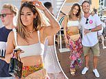 Erin McNaught flashes her washboard abs at the Cali Beach Club opening on the Gold Coast