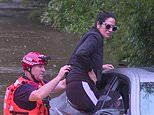 Woman rescued by SES volunteers after driving a BMW into floodwatersin Holgate, Central Coast