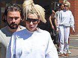 Olivia Attwood cuts very casual figure in a grey tracksuit as she steps out with fiancé Bradley Dack