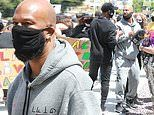 Common joins forces with NBA star Chris Paul at a youth-led Black Lives Matter protest in LA