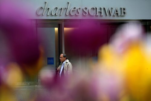Charles Schwab will give many of its employees $1,000 as part of its coronavirus response, but the bonus doesn't apply to its contract workers