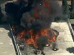 Aerial footage shows flames ravaging a commercial building used to grow marijuana in Los Angeles