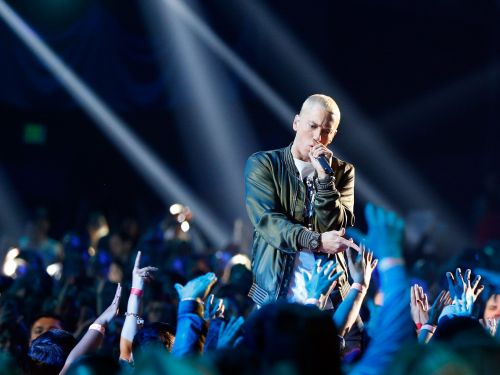 Eminem is sharing a 'personal' phone number with his fans. Here's the invite-only startup behind it that's betting texting celebs and influencers will be a big business