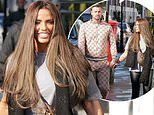 Katie Price and fiancé Carl Woods hold hands as they make their way to a London hair salon