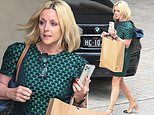 Name That Tune's Jane Krakowski flaunts her trim pins in a green mini-dress