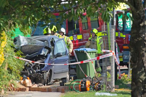 One dead and several injured after bin lorry crashes into house